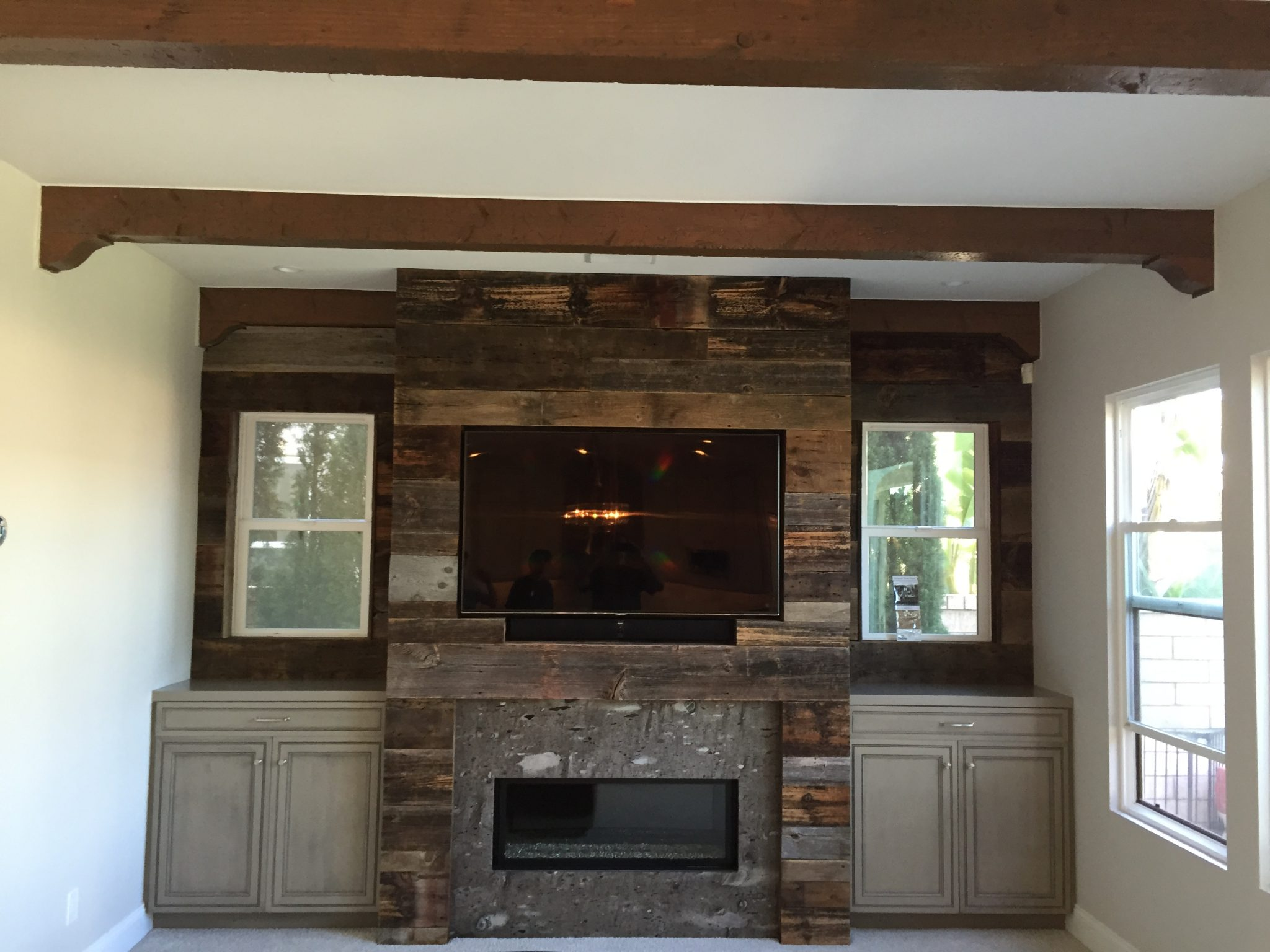 Custom Woodwall with TV and Grey Cabinets Remodel Hauser Houses